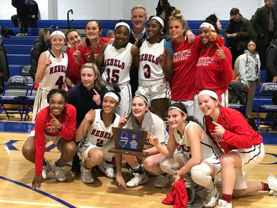 The Saddle River Day girls basketball team celebrates after winning the North Non-Public B title.