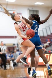 Westwood vs Lincoln in girls basketball Group 2 semifinal at Union High School on Thursday, March 7, 2019. WW #20 Meghan Riedel drives to the basket as L #2 Alaisha Mumford defends.