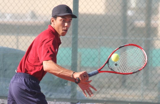 Wildcat senior Usaamah Sekka returned with a backhand during doubles play with senior teammate Tristan Nunn. The Deming duo won their doubles match.