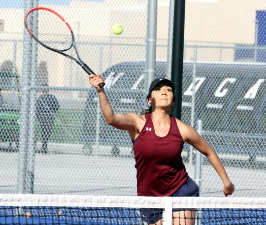 Senior Lady 'Cat Anyssa Maese reaches for the volley during Tuesday's doubles match against Chaparral. The Lady 'Cats scored a team sweep over the Lobos 9-0.