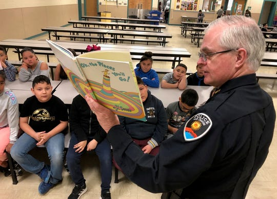 Las Cruces Police Department Chief Patrick Gallagher reads to students at Mesilla Park Elementary School for today's Read Across America Day.