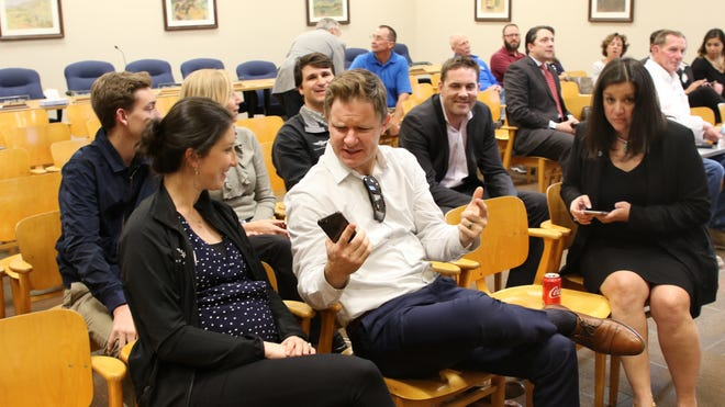 Members of Advanced Air gather before a special meeting of the Carlsbad City Council March 7.