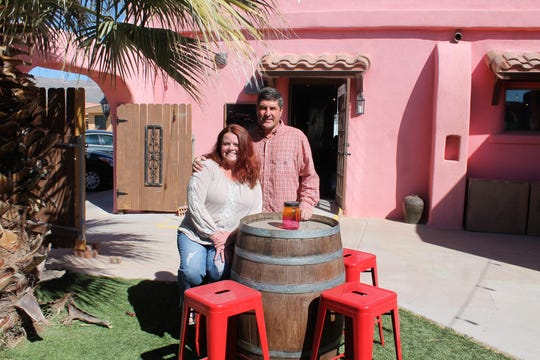 Tamara and Tyler Stucky stand in the beer and wine garden at Tall Pines Beer and Wine on White Sands Boulevard.