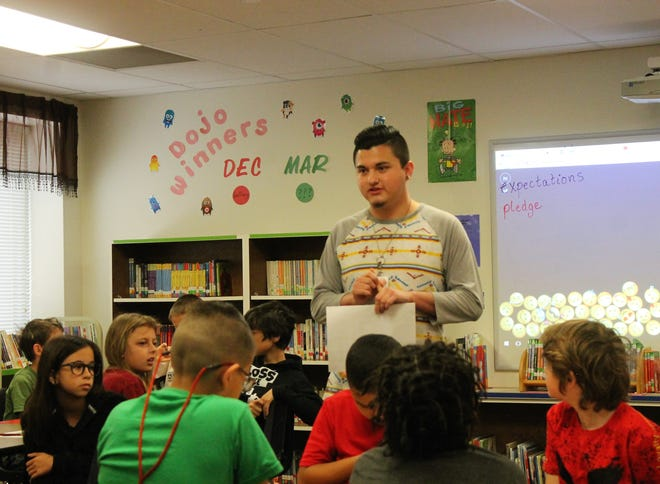 Yucca Elementary Librarian Ryan Sanders leads a discussion about digital citizenship to fourth graders on Thursday morning.