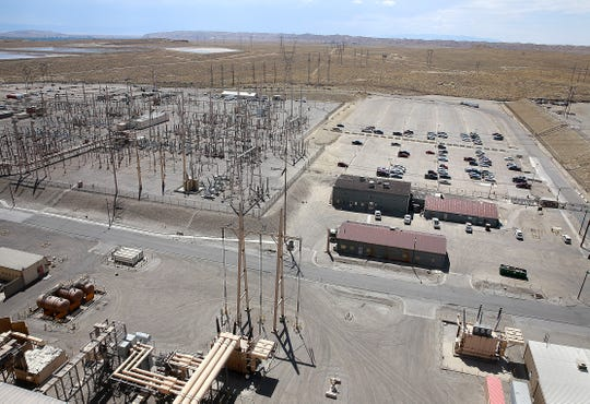 Transmission lines run from the San Juan Generating Station in August 2016.