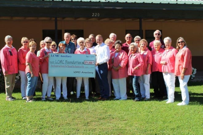 Lincoln County Medical Center Auxiliary presents check to LCMC .