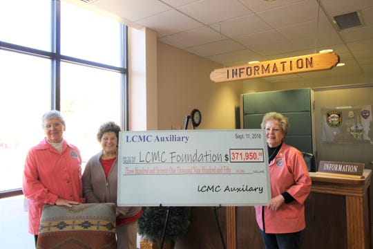 LCMC Auxiliary Committee members stand proudly next to a check they awarded the hospital (from left to right, Karen Hutchinson, Linda Langston, and Evelyn Witt.