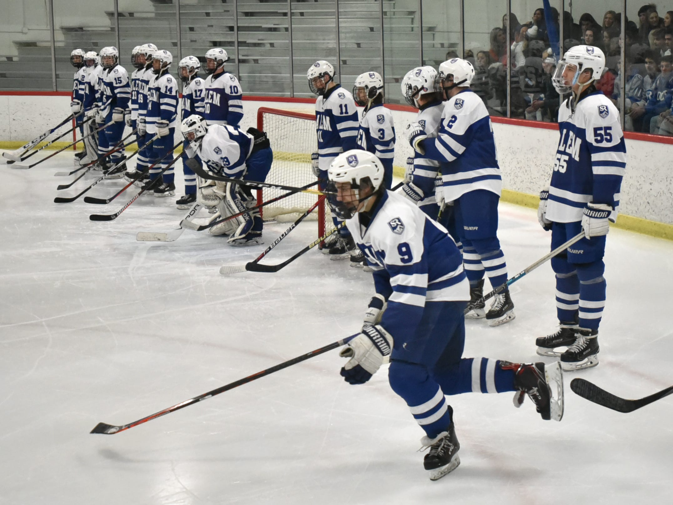 Salem High's Alex Schaumberger skates out to center ice after being introduced on March 6 at the Rock's MHSAA quarterfinal playoff hockey game against Detroit Catholic Central.