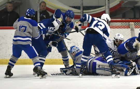 An absolute pile of bodies greets CC goal tender Stephen Sleva late in the third period. Sleva didn't allow a single goal all night - even after facing a 5 on 3 Salem power play.