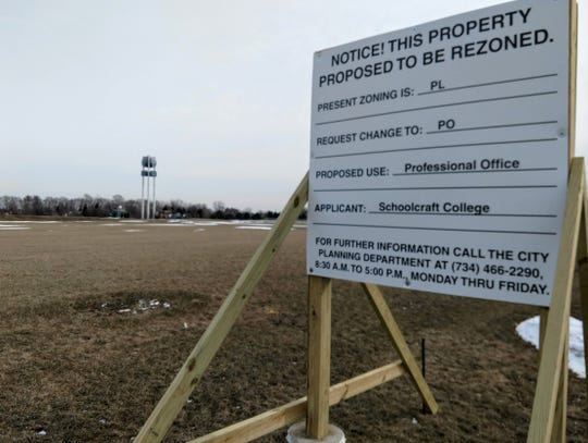A rezoning sign on the property proposed for rezoning at Schoolcraft College. The college is proposing a new building for an unnamed tenant or tenants at the site off Interstate 275 in Livonia.