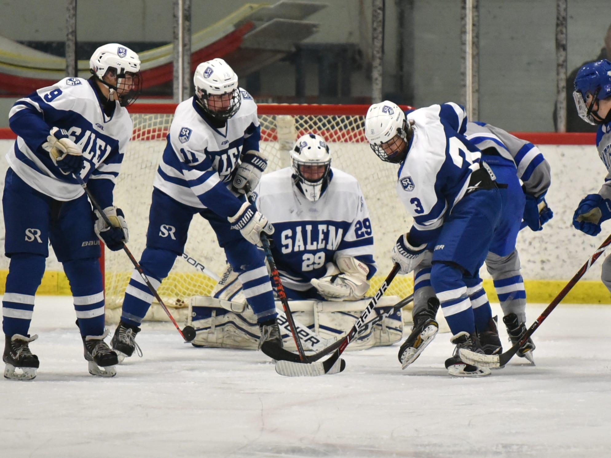Lots of activity surrounds Salem goalie Austin Goleniak.