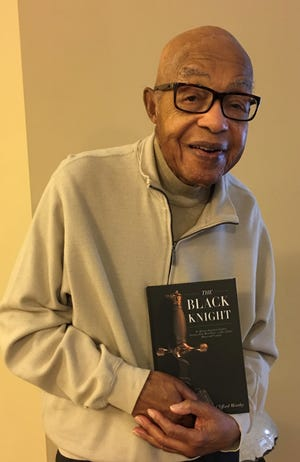 """Col. Clifford Worthy (Ret.) holds of copy of his recently published book, """"Black Knight An African American Family's Journey from West Point-A Life of Duty, Honor, and Country."""""""