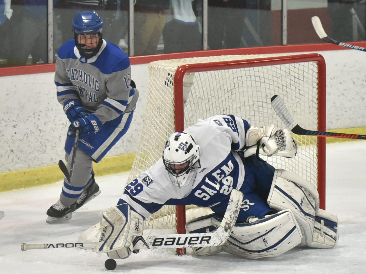 With Shamrock Dylan Dooley lurking nearby, Salem  High goalie Austin Goleniak pounces on a puck near his net.