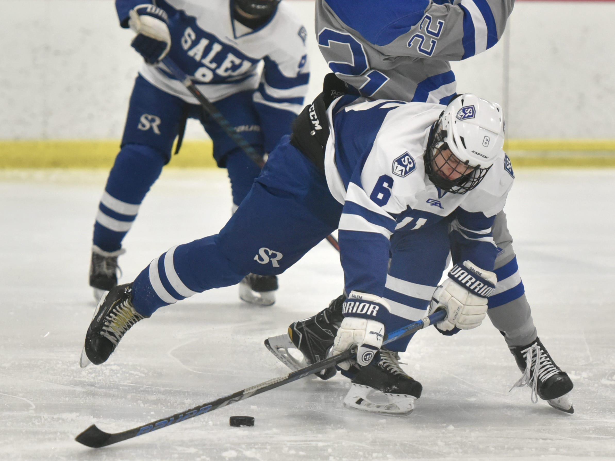 Salem Rock Kurt Jensen, (6) and CC's Ryan Pearson collide at center ice.