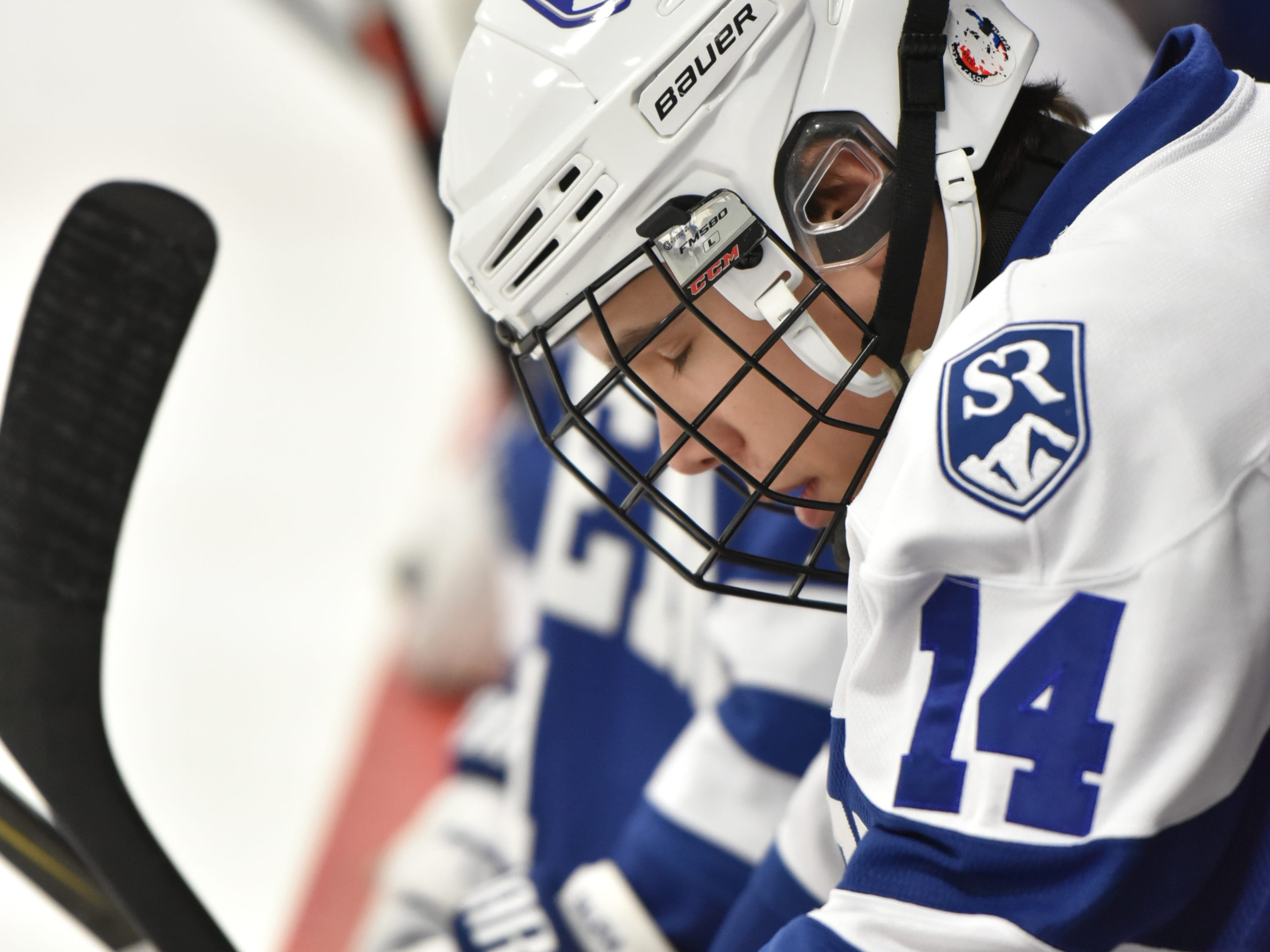 After a tough shift on the ice Salem Rock Nick Brosky bows his head on the bench.
