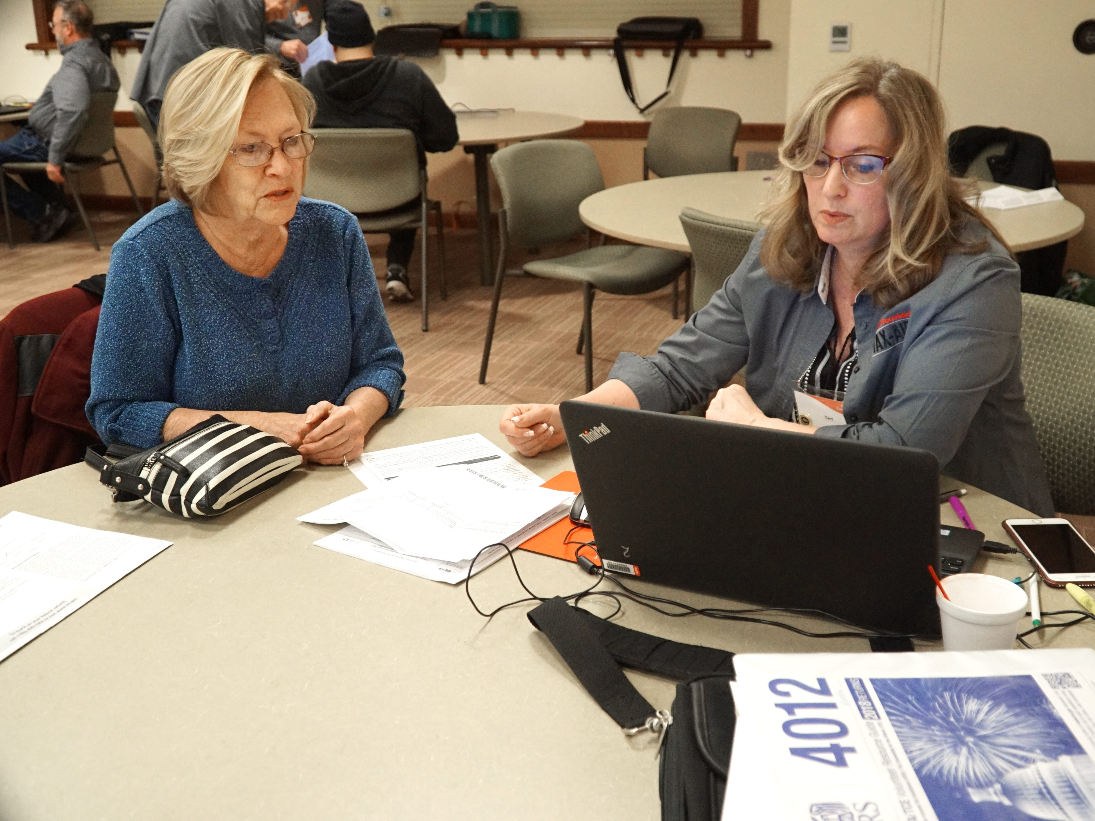 AARP tax prep volunteer Teri Kuehn assists Wanda Reid on March 7 in filing her 2018 federal and state of Michigan taxes at the Northville Community Center on March 7.