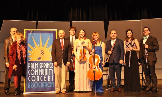 (from left) Palm Springs Concerts past President John Leonard, historian Elizabeth Press and President Christopher Seidel share the stage with Frisson Ensemble musicians violist George Meyer, violinist Adelya Nartadjieva, cellist Arlen Hlusko, Artistic Director and oboist Tom Gallant, flutist Anna Urrey, and clarinetist Bixby Kennedy.