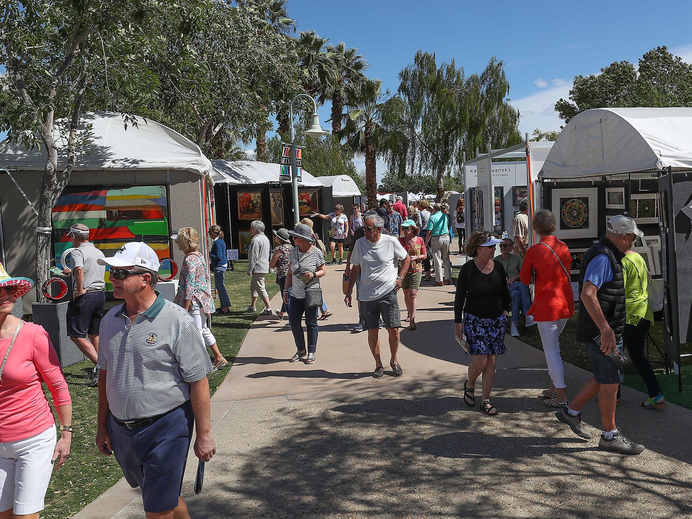 Visitors to the La Quinta Arts Festival check out the artwork, March 7, 2019.