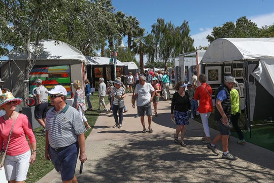 Visitors to the La Quinta Arts Festival check out the artwork, March 7, 2019.