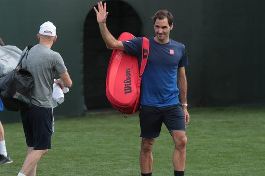 Roger Federer waves to fans after practicing at the BNP Paribas Open, Indian Wells, Calif., Wednesday, March 6, 2019.