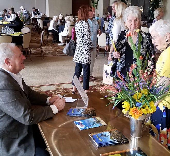 Jim Cornett speaks with guests.