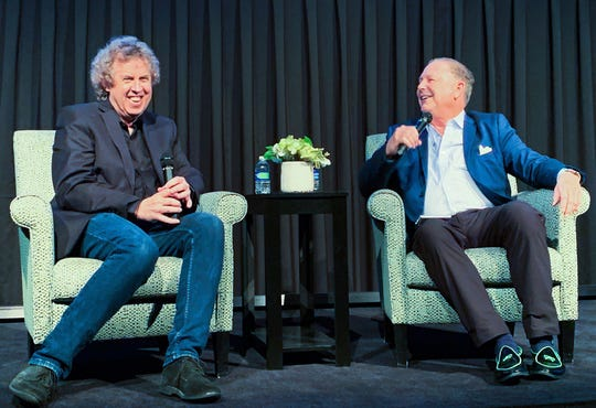 Honoree Bruce Fessier (left) and his co-host, Jamie Kabler, obviously enjoyed their interview on stage at the Rancho Mirage Library during a multi-part evening celebrating Fessier's 40-year anniversary with The Desert Sun newspaper.