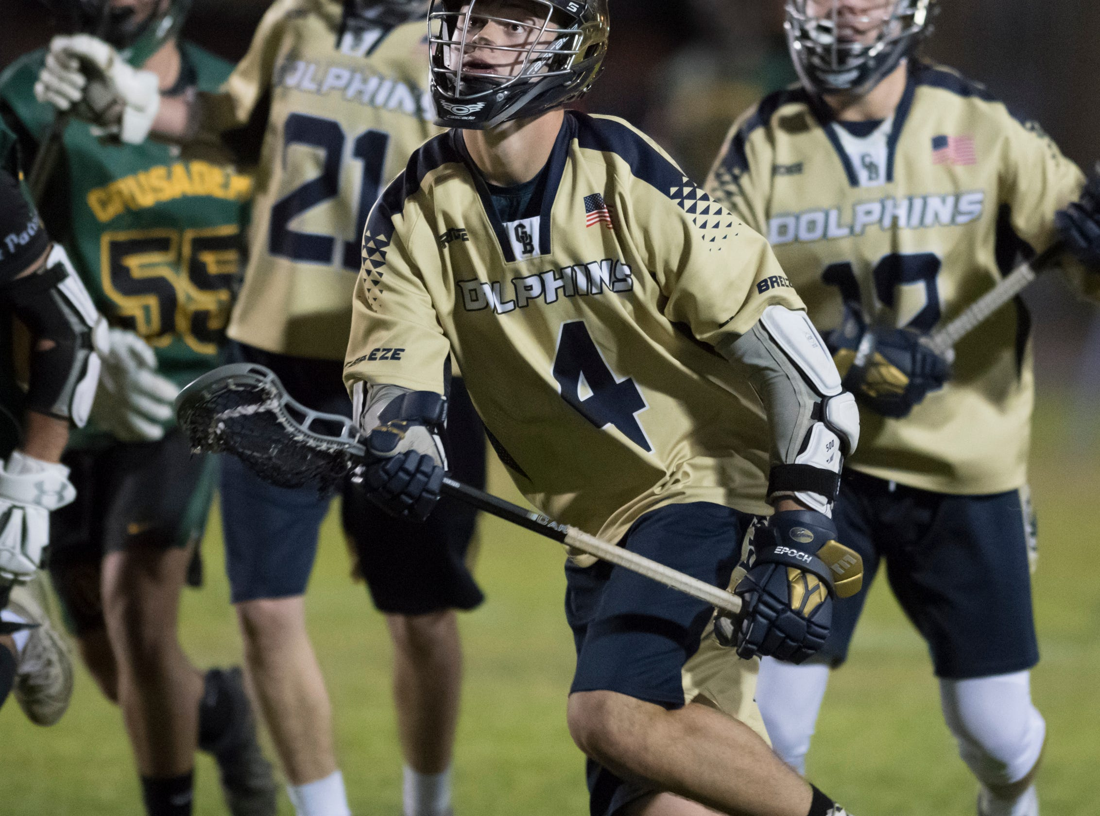 Tucker Smith (4) keeps his eyes on a loose ball during the Catholic vs. Gulf Breeze boys lacrosse game at Gulf Breeze High School on Wednesday, March 6, 2019.
