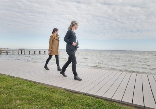 SCAPE designer Liz Camuti, left, and project manager Lee Altman scout Sanders Beach and the surrounding neighborhood in Pensacola on March 7. They are studying the area to improve the accessibility, connectivity and resiliency of Pensacola's western waterfront.