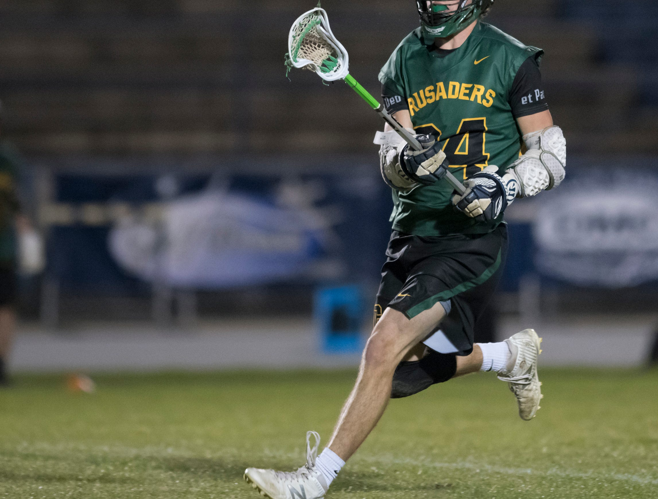 William Butler (24) passes the ball during the Catholic vs. Gulf Breeze boys lacrosse game at Gulf Breeze High School on Wednesday, March 6, 2019.