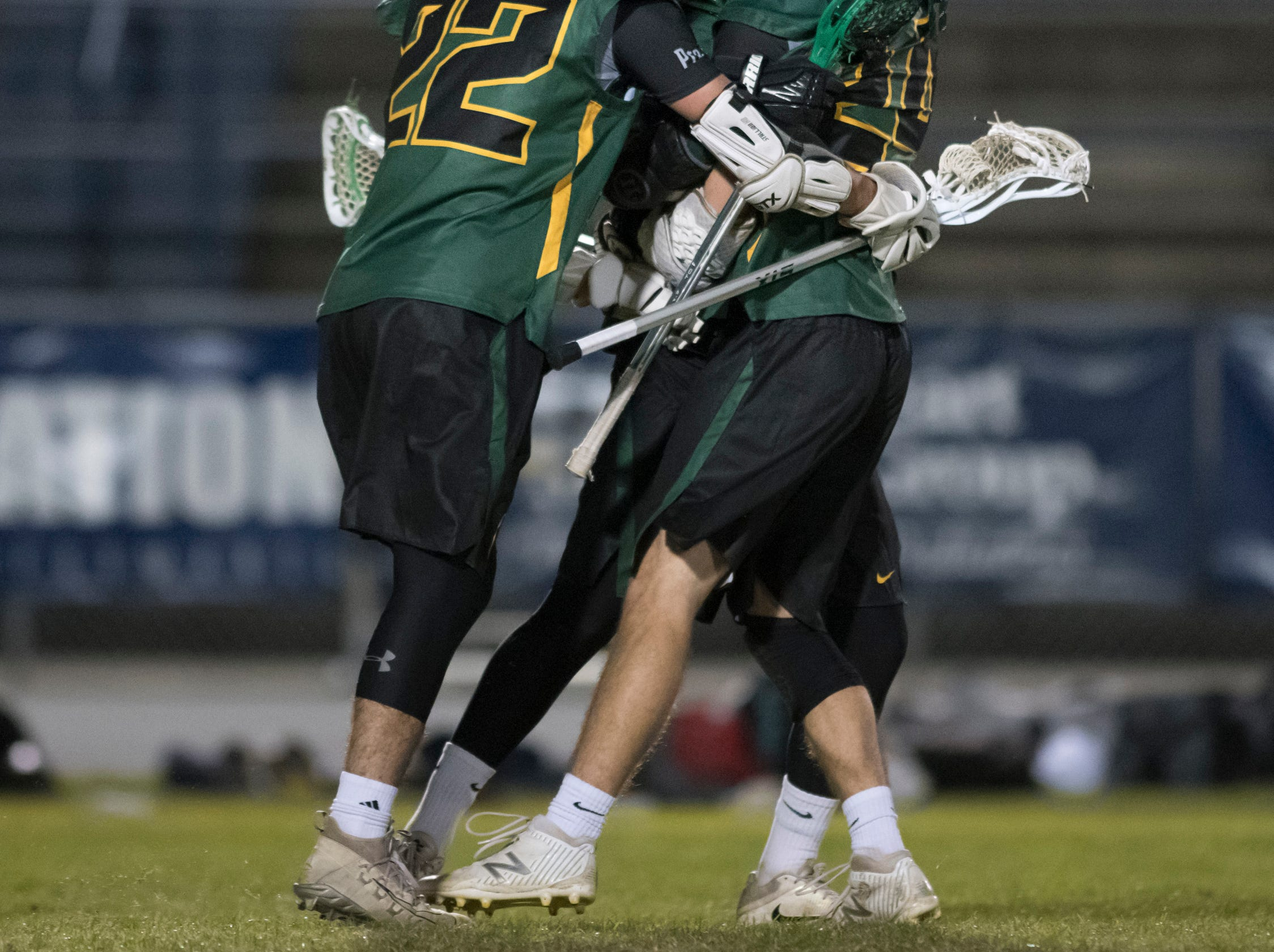 The Crusaders celebrate after scoring a goal during the Catholic vs. Gulf Breeze boys lacrosse game at Gulf Breeze High School on Wednesday, March 6, 2019.