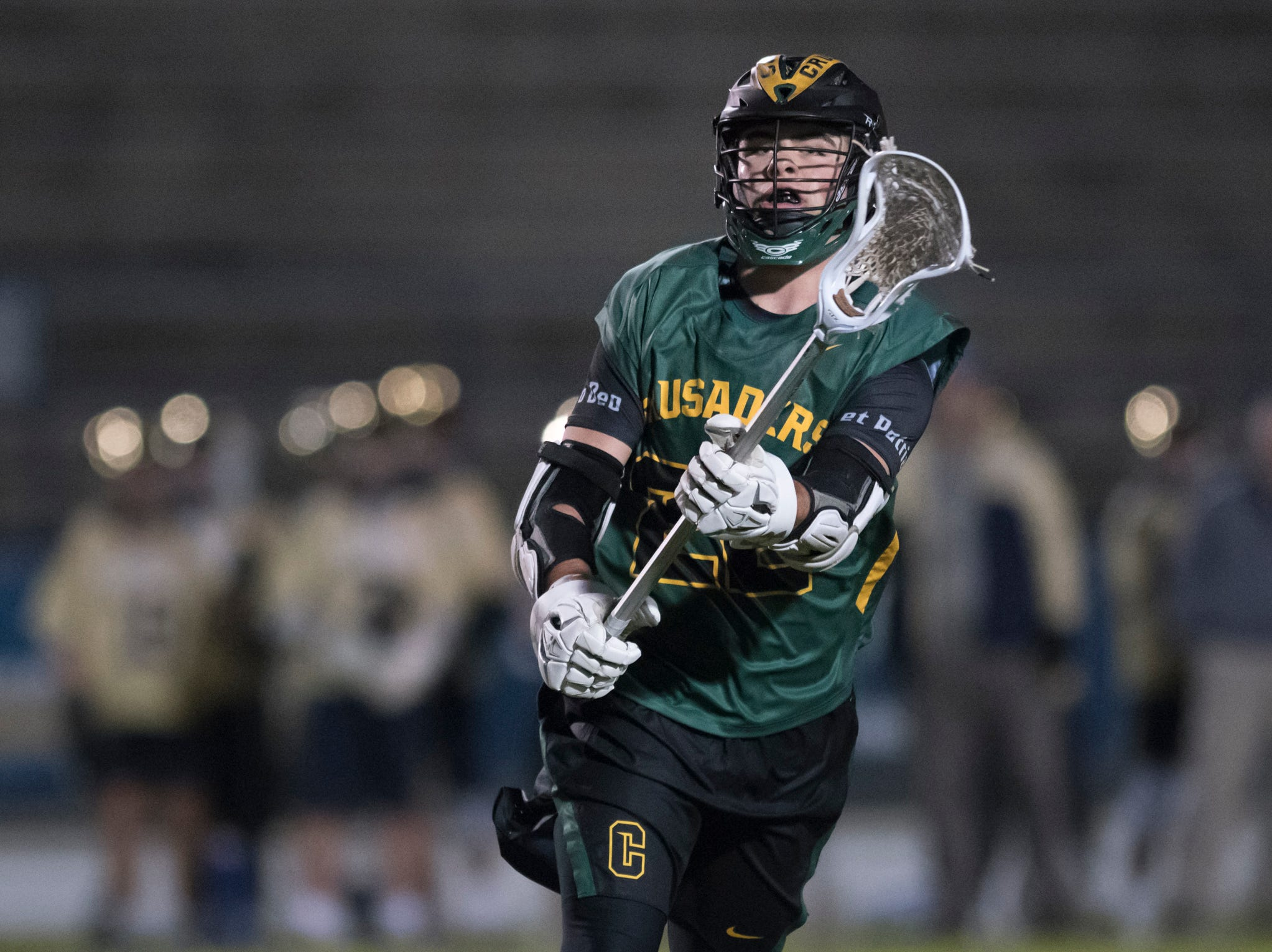 Ryan Campion (22) passes the ball during the Catholic vs. Gulf Breeze boys lacrosse game at Gulf Breeze High School on Wednesday, March 6, 2019.