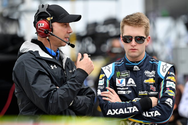 NASCAR crew chief Chad Knaus talks with his driver William Byron, right,  during qualifying for the Daytona 500 at Daytona International Speedway.