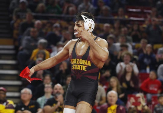 ASU's Zahid Valencia reacts to defeating Michigan's Myles Amine in a match Jan. 5 at Wells Fargo Arena.