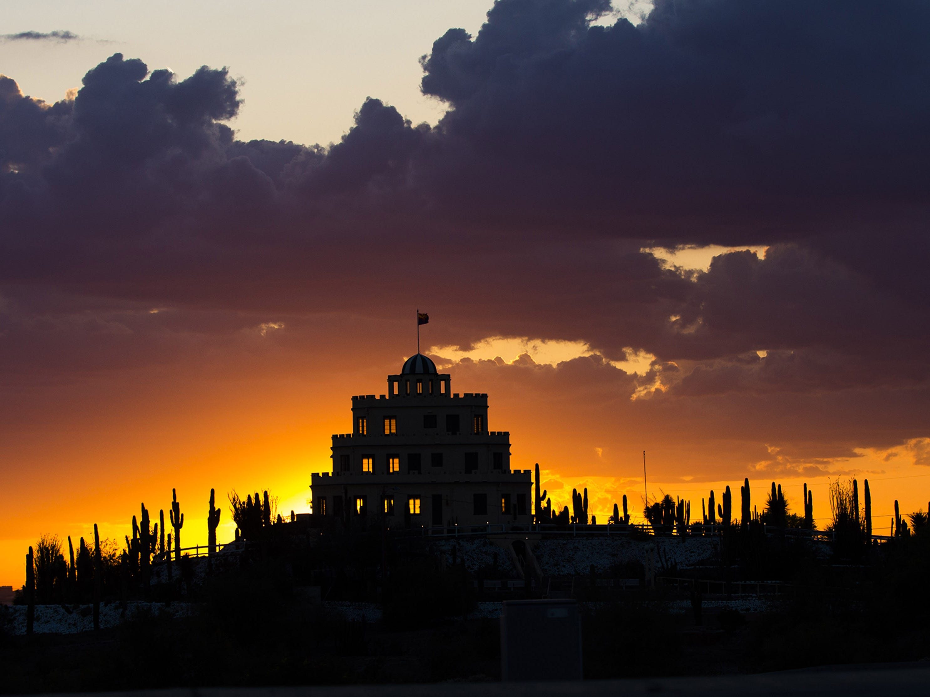 The sun sets behind Tovrea Castle in Phoenix March 27, 2017.