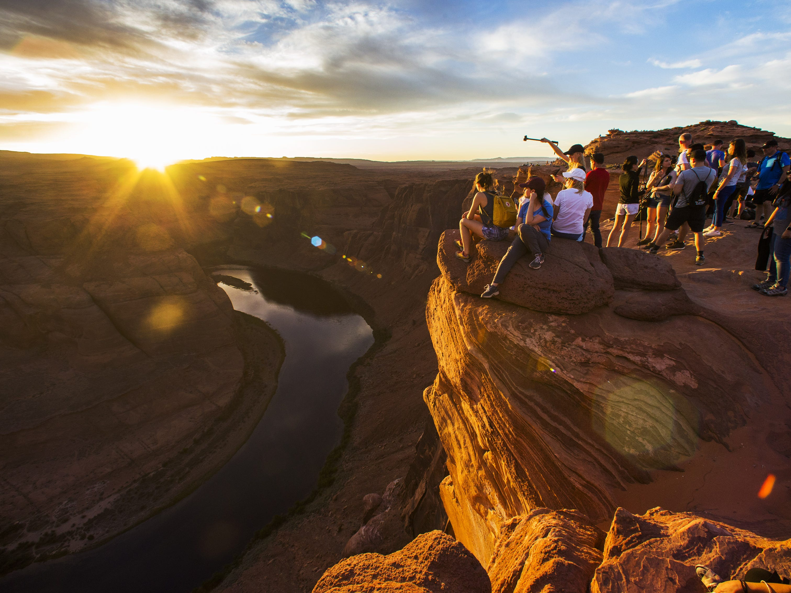 Visitors enjoy the sunset from Horseshoe Bend near Page, Ariz. May 9, 2018.