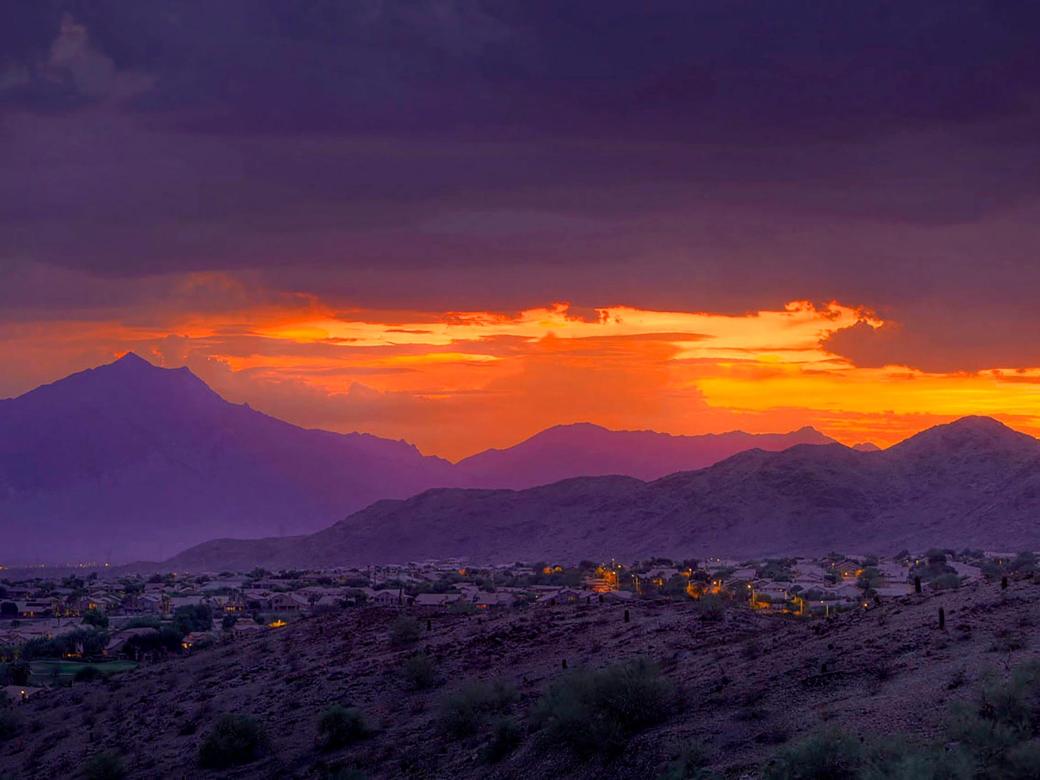 The setting sun paints a pretty scene of Ahwatukee.