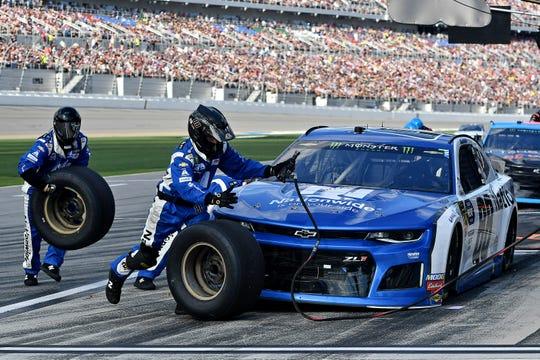 NASCAR driver Alex Bowman makes a pit stop during the Daytona 500 at Daytona International Speedway.