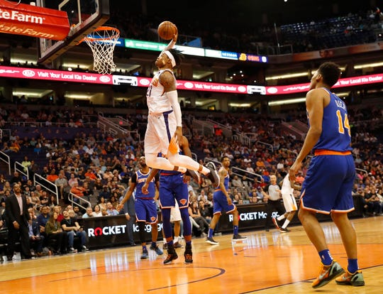 Phoenix Suns forward Richaun Holmes (21) slams two against the New York Knicks during the second quarter in Phoenix March 6, 2019.
