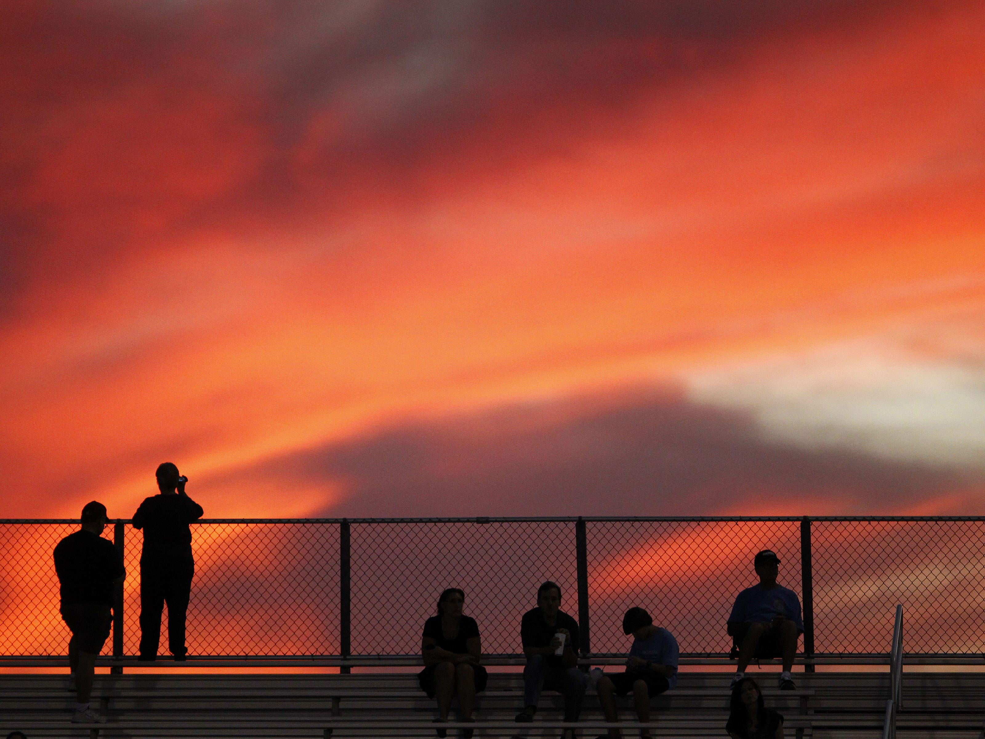 Football fans watch the sunset as Desert Vista and Hamilton prepare to square off  Friday,  Oct. 5, 2012 in Chandler.