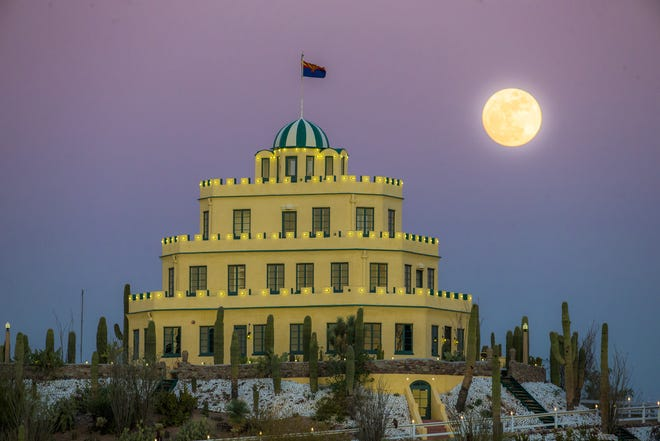 A nearly full moon rises behind Tovrea Castle in Phoenix on January 11, 2017.
