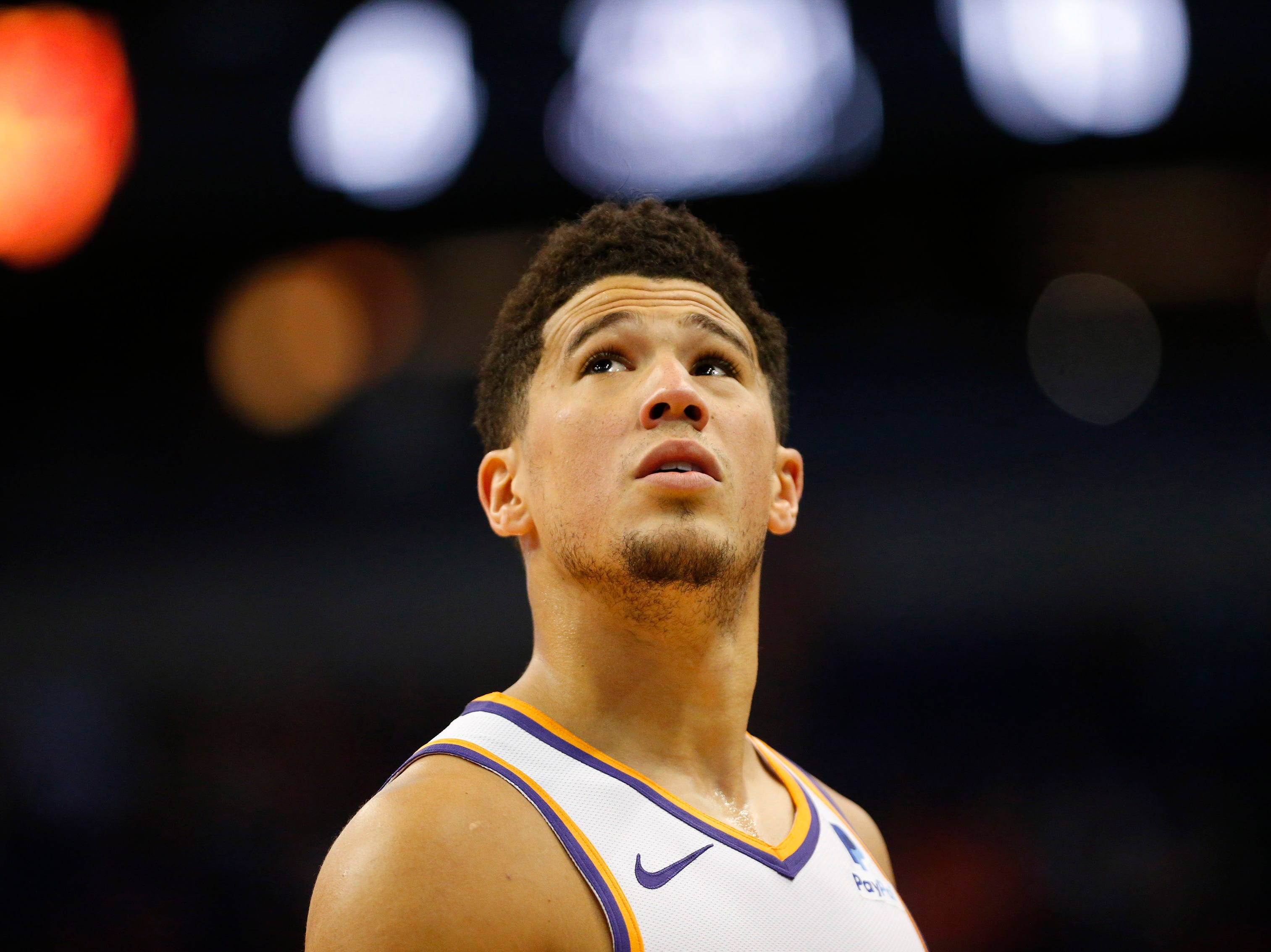 Phoenix Suns guard Devin Booker (1) looks up at the replay board during the first quarter against the New York Knicks in Phoenix March 6, 2019.