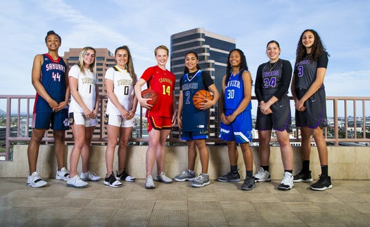 (left to right) Alyssa Brown of Tuscon Sahauro, Haley and Hanna Cavinder of Gilbert, Anna Ostlie of Chaparral, Senya Raboin of Shadow Mountain, Leilani McIntosh of Xavier Prep, Dominique Phillips and Alexandra Zelaya of Millennium pose for azcentral sports All-Arizona girls basketball team photo at the Republic Media Building in Phoenix, Monday, March 4, 2019.