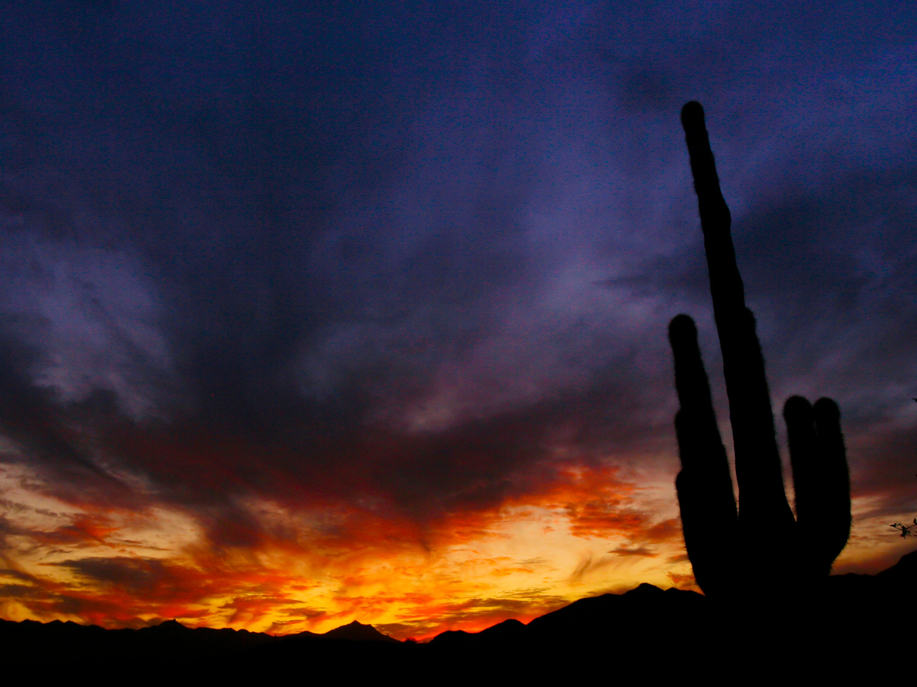 The sun sets beyond the Estrella Mountains as seen from Ahwatukee Saturday, Oct.10, 2009 in Phoenix.