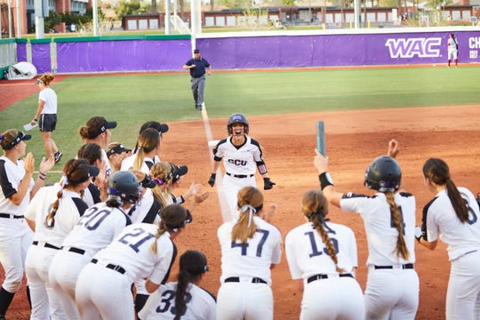 Kaileigh Holland nears the plate after a solo home run for Grand Canyon's first run against Florida State Wednesday, March 6, 2019.