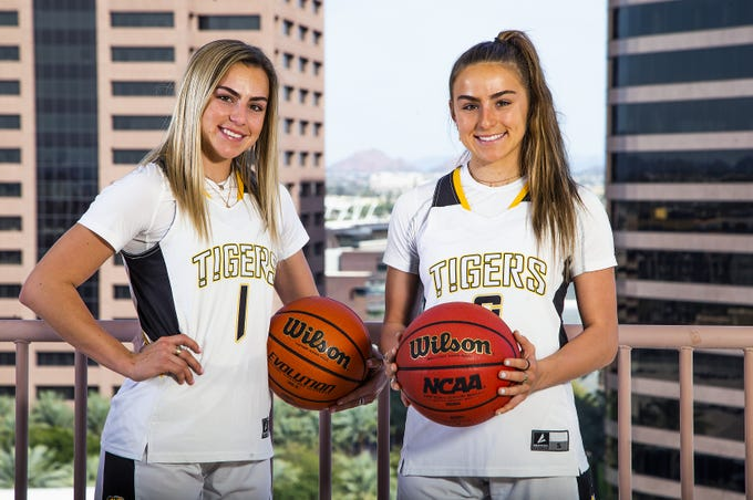 Haley and Hanna Cavinder (left to right) pose for the azcentral sports All-Arizona girls basketball team at the Republic Media Building in Phoenix, Monday, March 4, 2019.