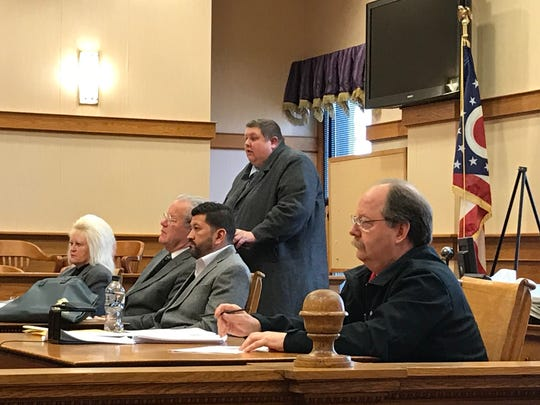 Port Clinton Mayor Hugh Wheeler, right, appears in Ottawa County Common Pleas Court for a hearing in early 2019 after a city employee sought a civil protection order against him for allegedly making violent threats.