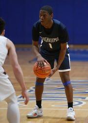 Poughkeepsie's Jamik Carter surveys the New Paltz defense during a Class A regional semifinal on March 6.
