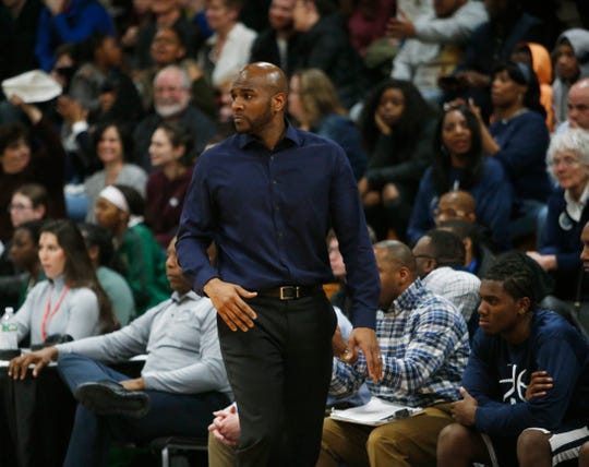 Poughkeepsie coach Cody Moffett stares on at the action during a Class A regional boys basketball semifinal against New Paltz on March 6.