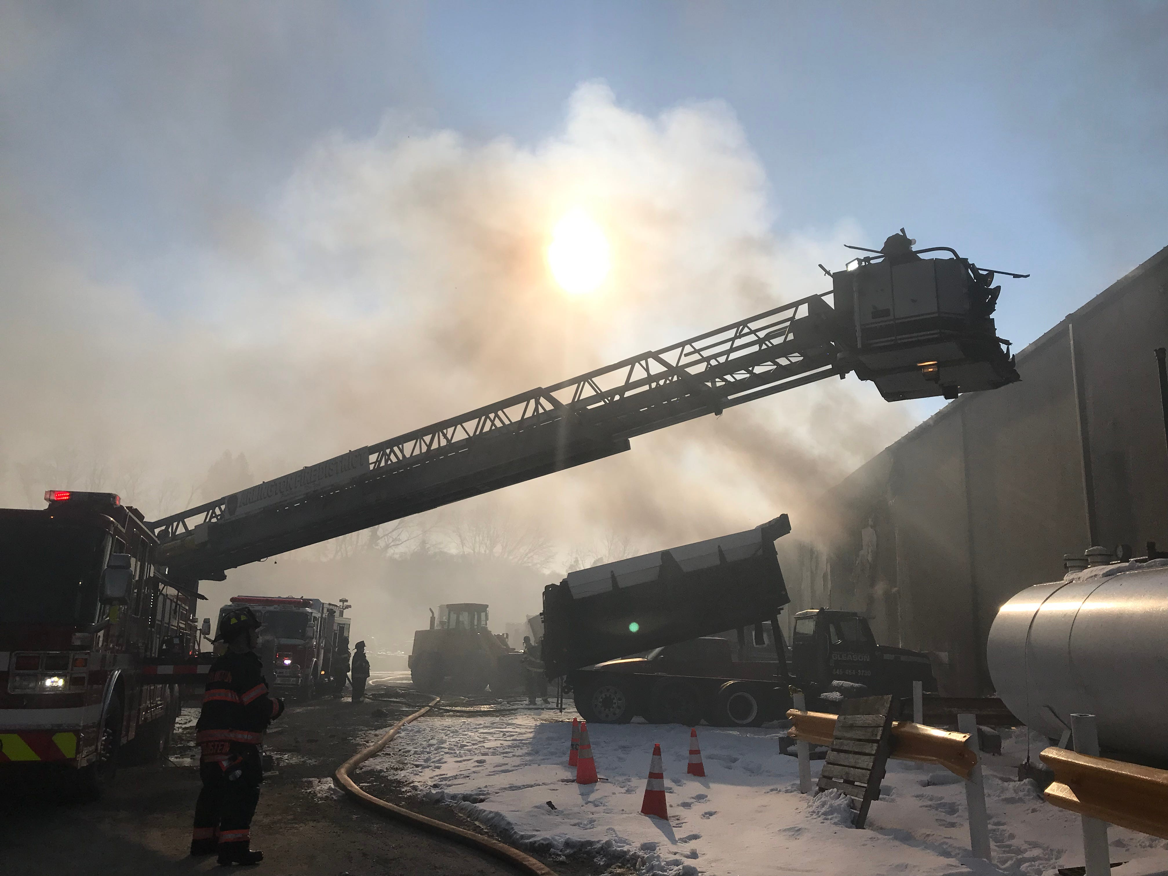 Firefighters work to put out a fire at the Thomas Gleason excavation company in Poughkeepsie Thursday.