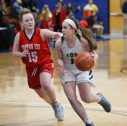 Roosevelt's Kelsea Demelis drives to the basket against Tappan Zee during a Class A girls basketball regional semifinal on March 6, 2019.